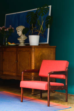 red vintage armchair with apollo head